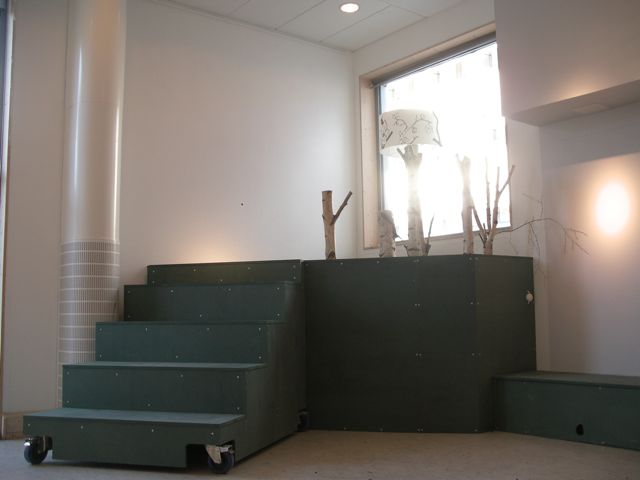 Stage, movable stairs and a lamp